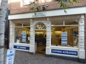 The Clothing Alteration Company. Decorations around the door and windows.